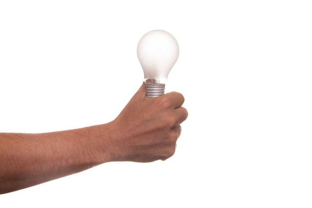 holiding light bulb