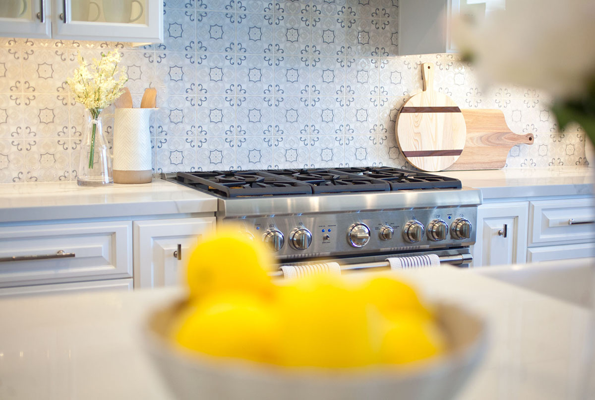 Details of a kitchen remodel by JY Design Interiors. Close up on back splash tiles above stove