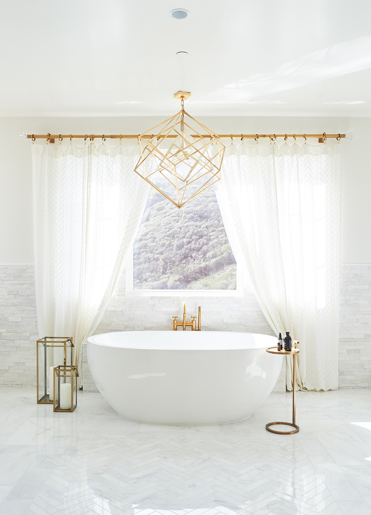 Photo of a newly installed bathtub in front of a window by Jaki Yermian of JY Design Interiors