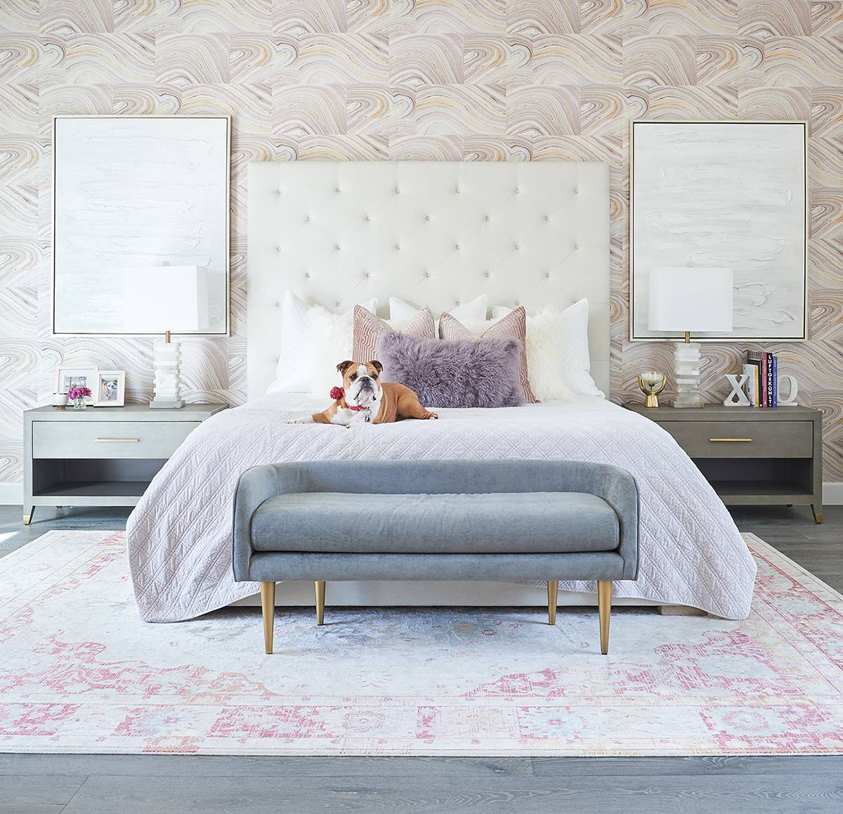 Photo of bedroom remodel done by Jaki Yermian of JY Design Interiors. There is an english bulldog posed on the bed