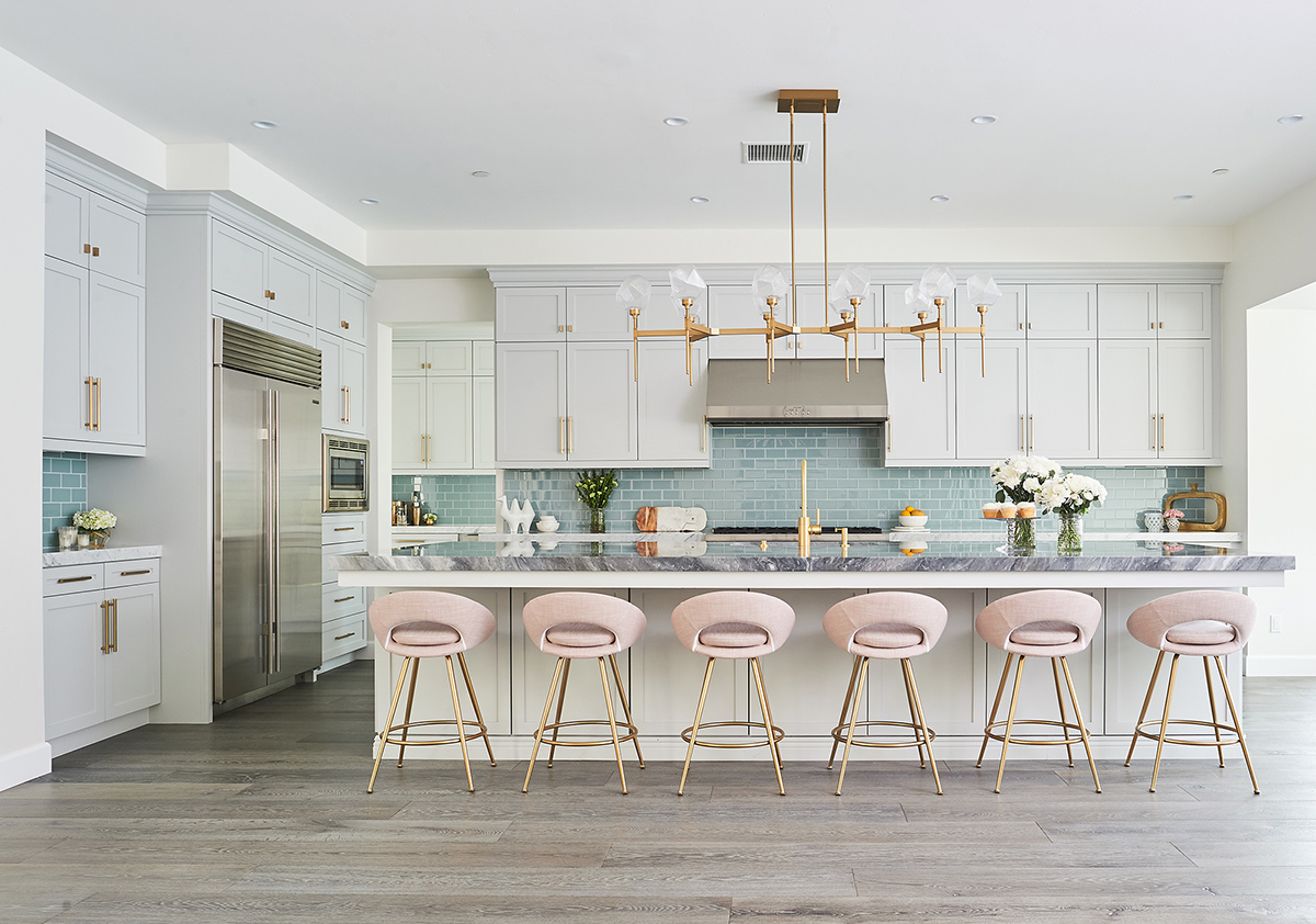 Pink barstools line a new kitchen island in a kitchen remodel done by Jaki Yermian of JY Design Interiors