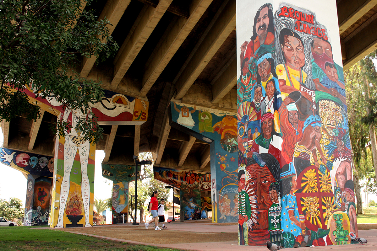 A close up of the murals drawn on the freeway columns in Chicano Park