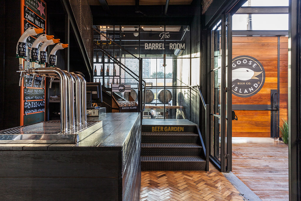 Goose Island Brewhouse designed by SuperLimão Studio and McKinley Burkart Architects, photography by Maira Acayaba