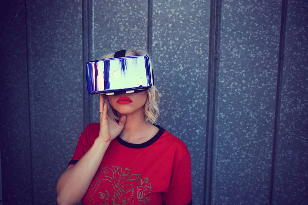 Interior Design Trends 2020 - 3D/VR Interior Design. Blonde woman with red shirt wearing a VR headset