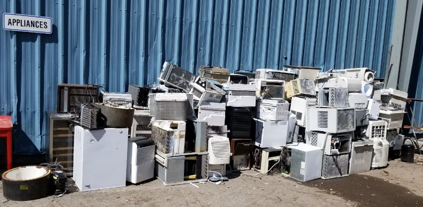 Appliances awaiting recycling. Appliances are difficult to recycle.